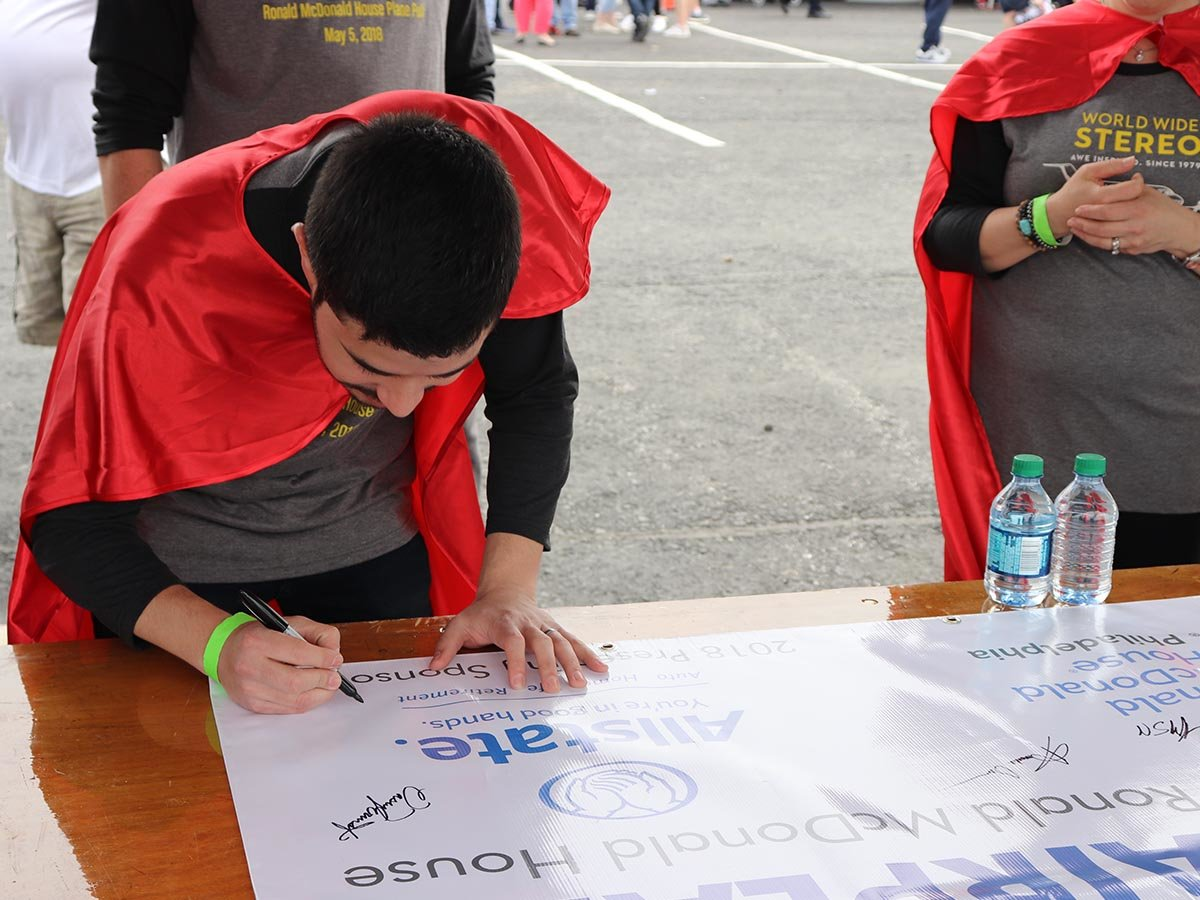 Chris signing the plane pull banner