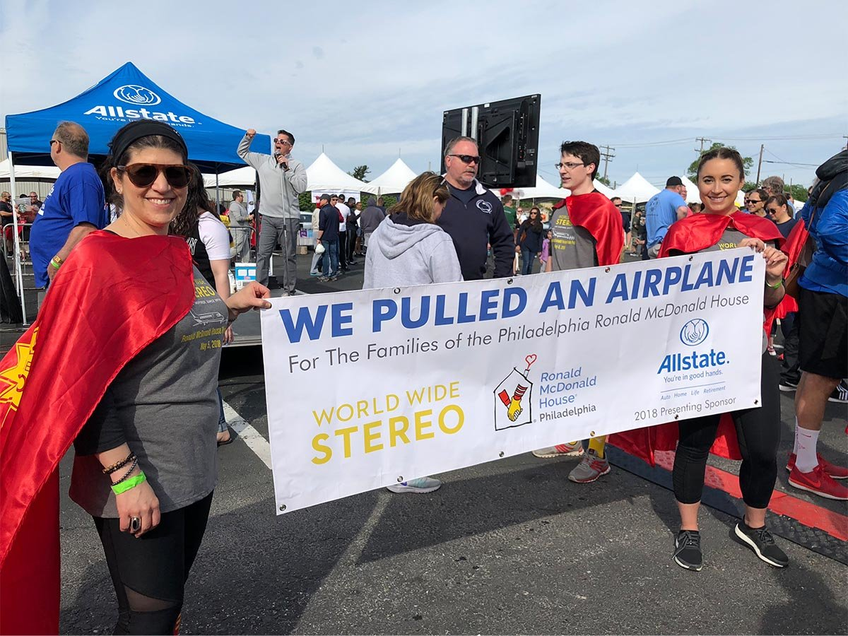 Fern and Casey hold the plane pull banner