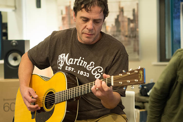 Local guitarist, Ricky Smith, plays Eric Clapton on a Martin Guitar