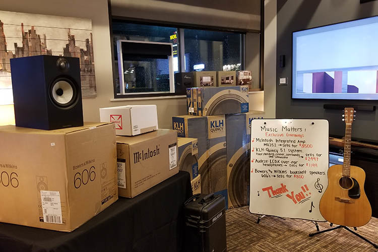 Giveaways of the night, featuring products from Bowers & Wilkins, McIntosh, KLH, Audeze, and Focal
