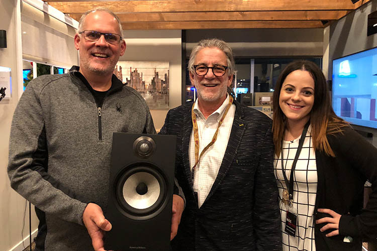 The new owner of a pair of Bowers & Wilkins 606 Bookshelf Speakers