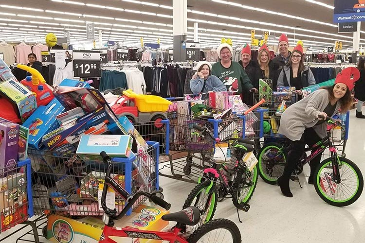WWS elves hard at work shopping for the kids.