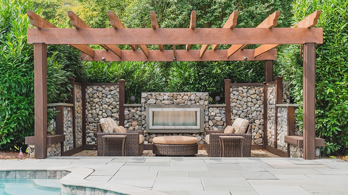 outdoor fire pit next to in-ground pool