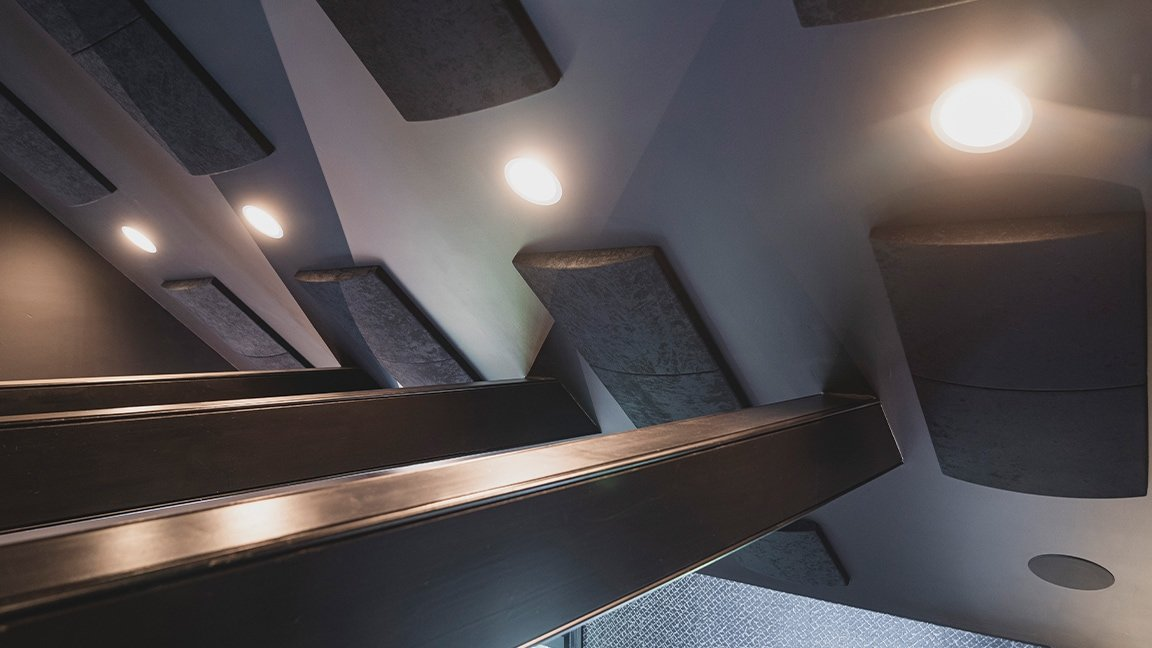 ceiling with acoustic panels, in-ceiling speakers, and lights