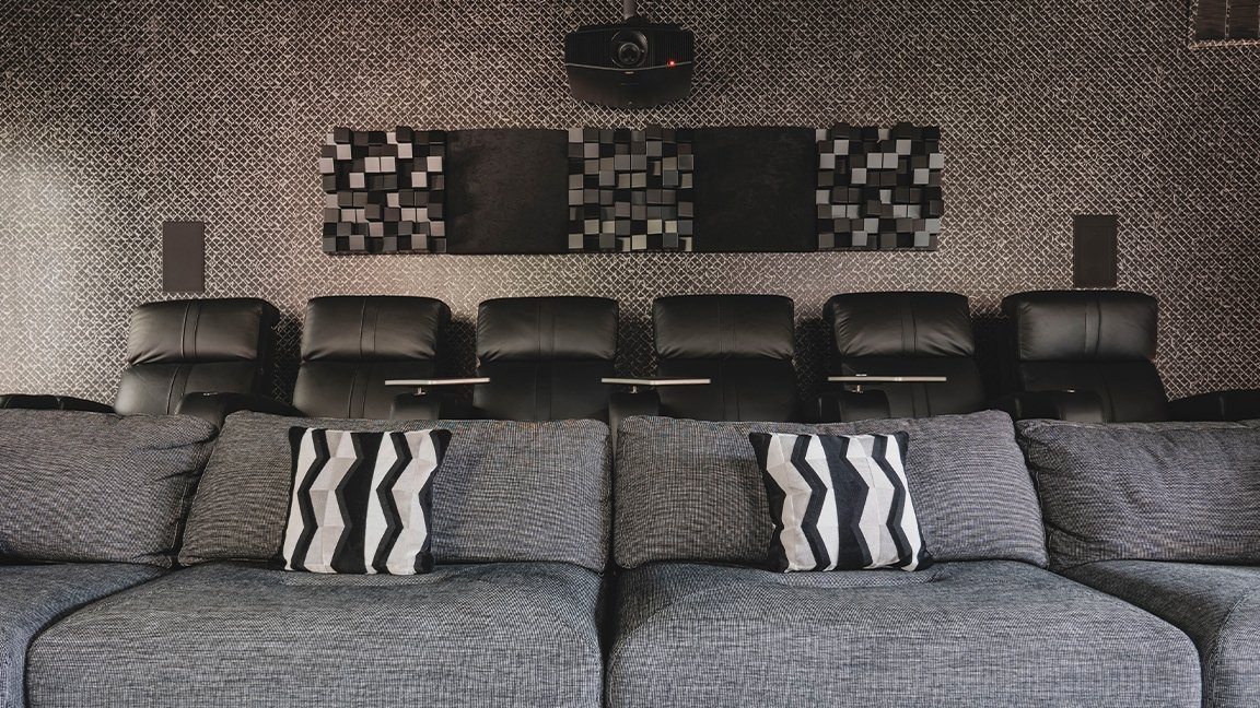 home theater seating with zebra pillows and acoustic panels